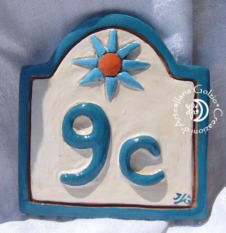 Numero civico in ceramica con sole