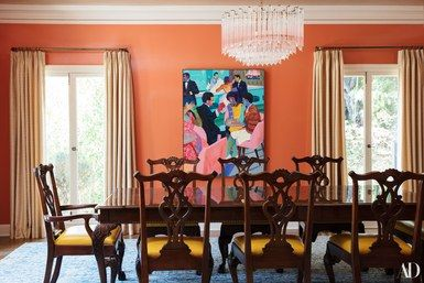 """""""In my dining room, the paint is high-gloss lacquered paint. The feeling is silver leaf. Katie designed some of the Plaza in New York, so she knows the grandness of high-gloss paint,"""" says Kaling   archdigest.com   www.bocadolobo.com #bocadolobo #luxuryfurniture #exclusivedesign #interiodesign #designideas #dining #diningtable #luxuryfurniture #diningroom #interiordesign #table #moderndiningtable #diningtableideas #moderndiningroom #diningspace #diningarea #diningchair #diningset…"""