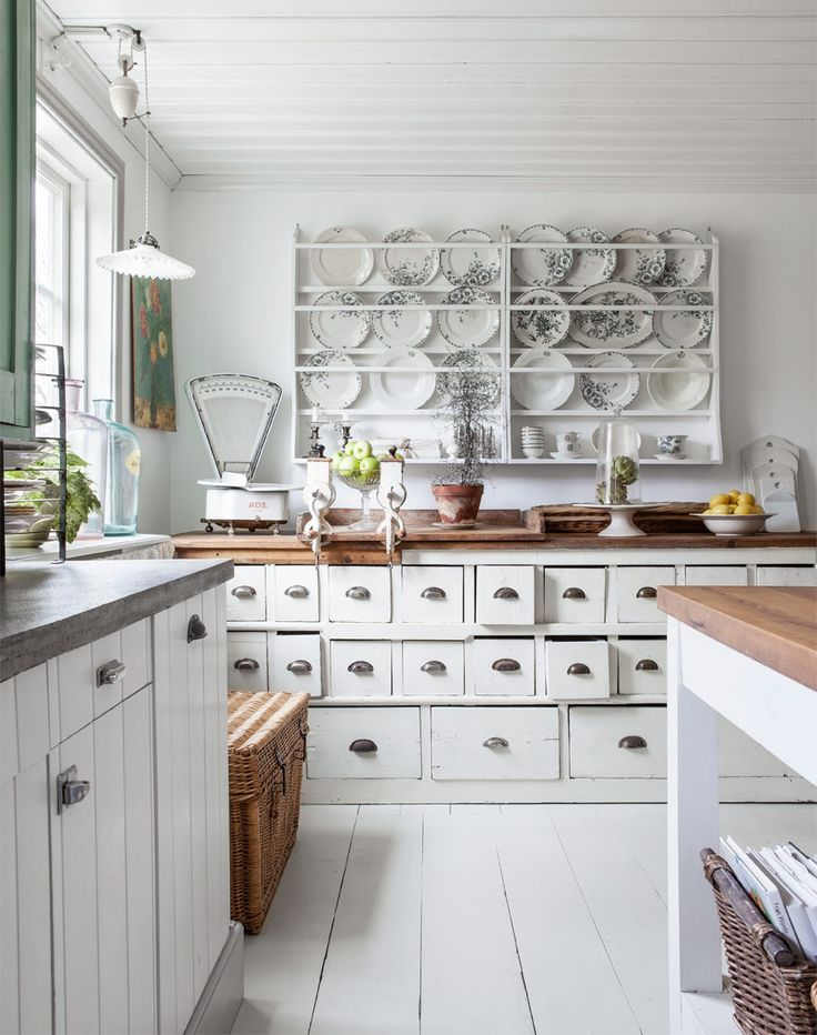 Country/Cottage Swedish kitchen, plate rack, butcher block and concrete counters...