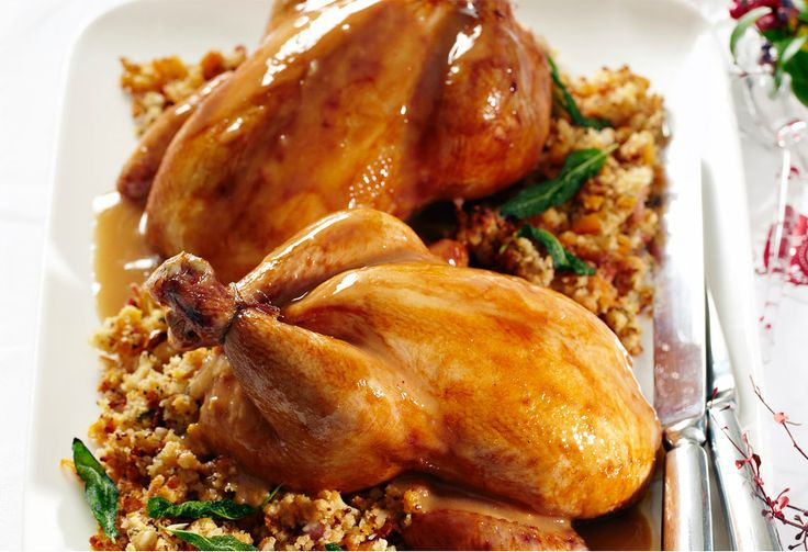 A nutty herbed stuffing elevates these roast chickens to a very elegant main dish.