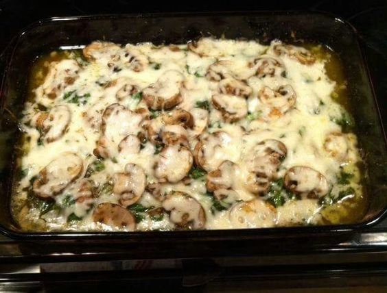 Yummy Low Carb Meal!! 6 thin sliced chicken breasts 1 container of green onion cream cheese 1/4 cup olive oil 1/2 cup chicken broth 1 Large package of sliced mushrooms 1 small bag fresh baby spinach Sprinkle of Weber Herb and Garlic Seasoning Sprinkle of pepper 8 oz shredded mozzarella cheese 9x13 pan lay out chicken in single layer, top with spinach and mushrooms. Then sprinkle the seasonings over the top. Soften cream cheese and whisk in olive oil and chicken broth. Pour over mixture. Lay…