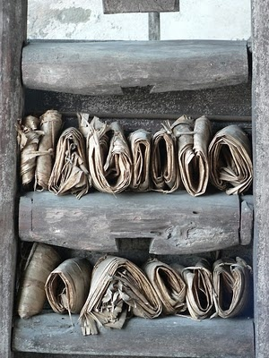 Rustic wooden shelves and textiles. 'One' by Victoria Alexander.