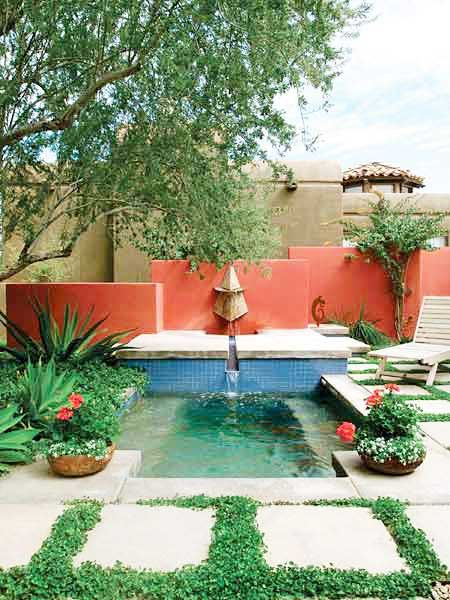 Used carefully, colored walls and structures can create different effects in gardens. Warm oranges and reds can make an outdoor space vibrate. These bright coral walls make a vivid backdrop for this courtyard pool's blue tiles and echo the hues of the potted geraniums. A colored wall can draw attention away from undesired views. (Photo: Photo: Thomas J. Story)