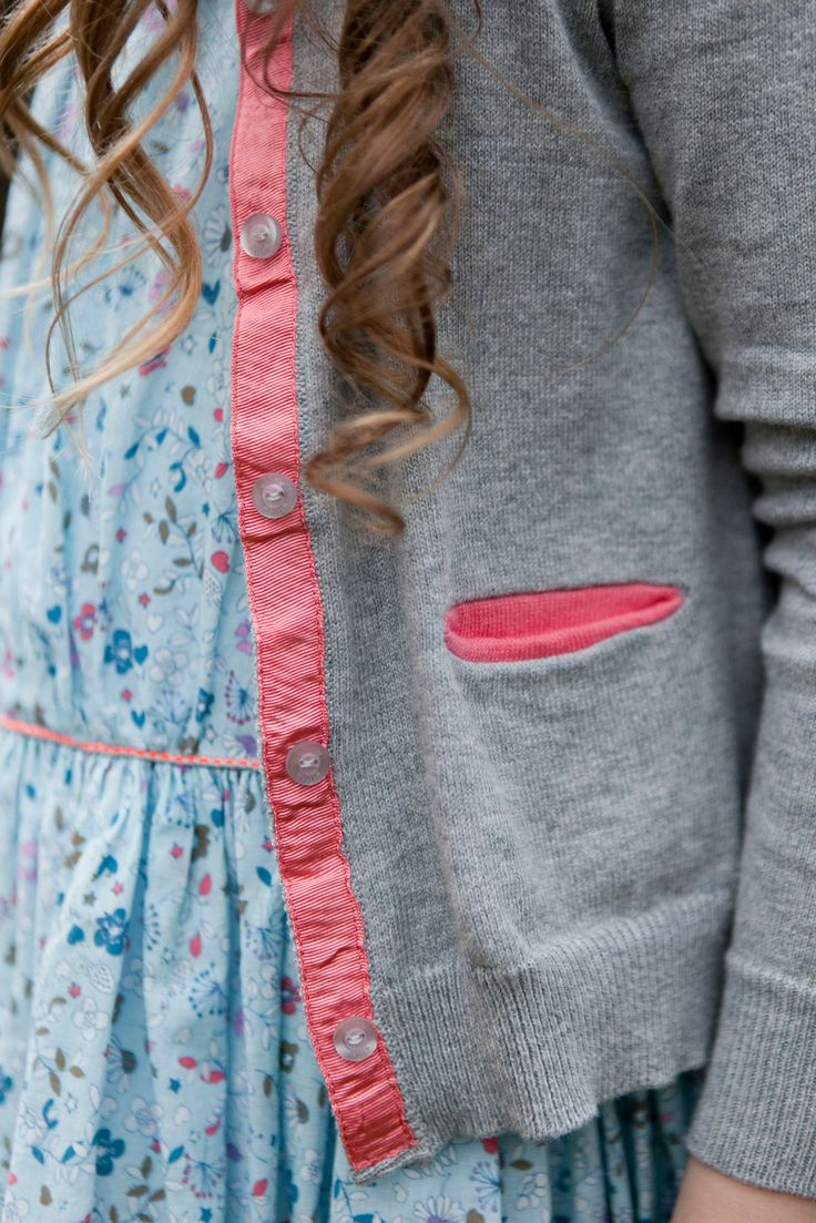 Knitted grey cardigan with pink grosgrain trim, pockets and branded Willow buttons