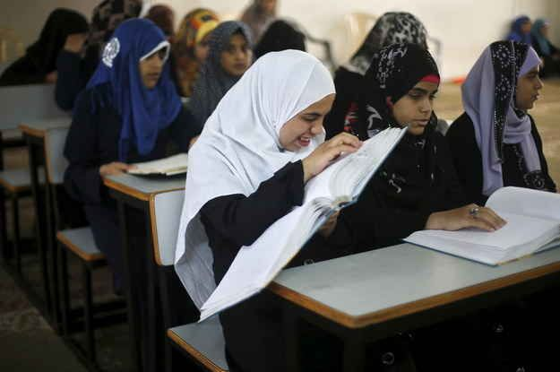Gaza City - Blind and visually impaired girls read the Qur'an in Braille.
