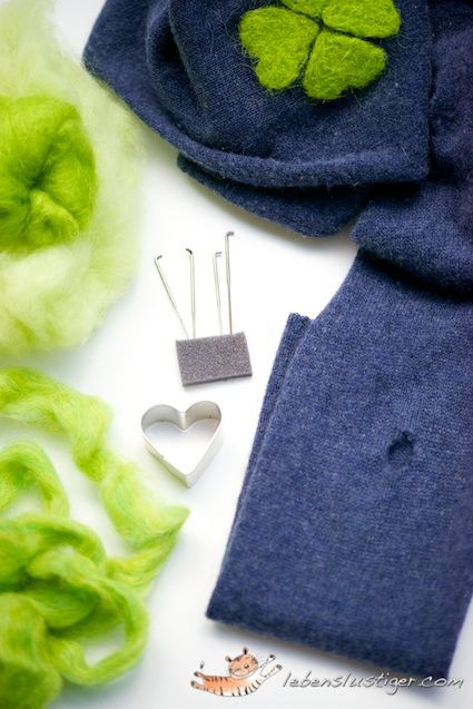Repair the holes in a sweater with needle felting