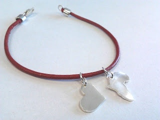 bracelet with red leather thong and sterling silver charms.