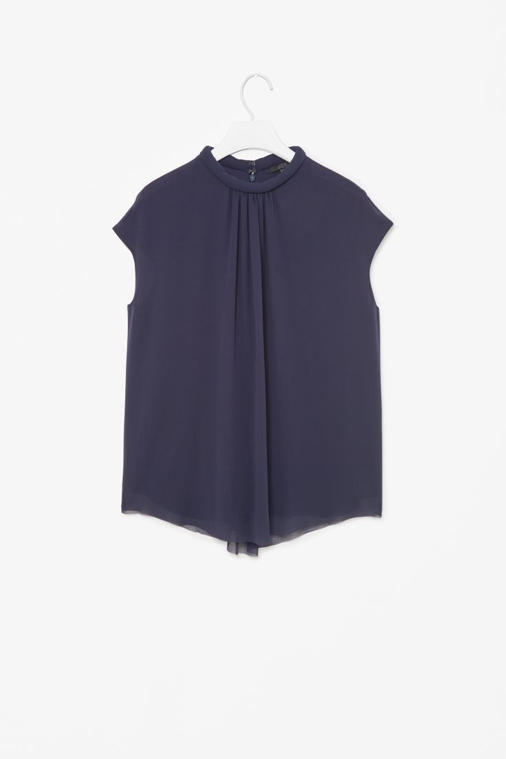 Top with rounded neckline