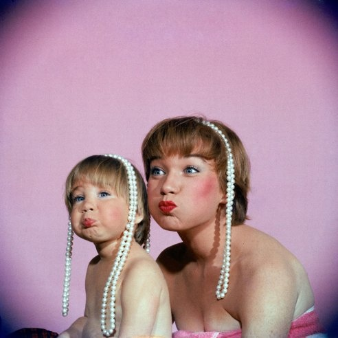 Shirley MacLaine and her daughter Sachi Parker playfully pout, 1959. By Allan Grant.
