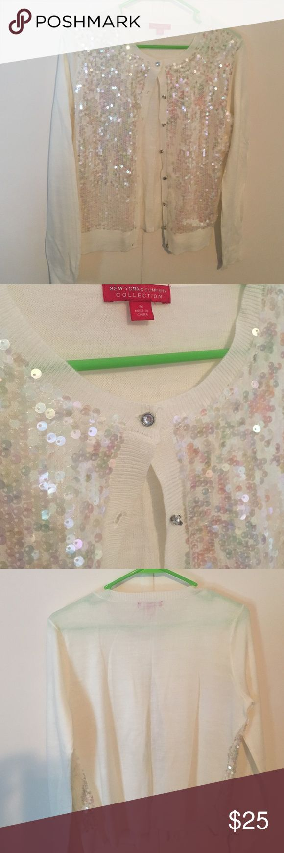Sequin Cardigan Sequin Cardigan with iridescent sparkles and rhinestone buttons. From New York & company.  Like new condition just needs pressing. Wore one time to Christmas Party. Very pretty for the Holidays. New York & Company Sweaters Cardigans