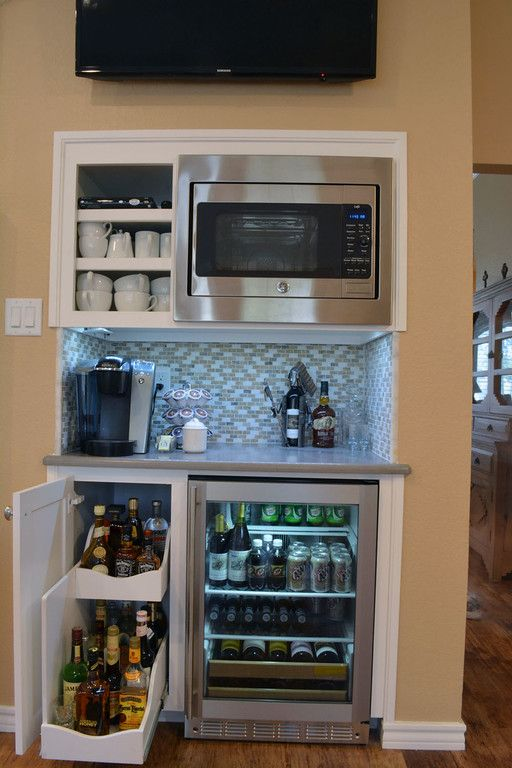 Custom Beverage Bar with slide-out wine rack, built in cooler and built-in microwave! #beveragebar #homeremodeling #customdesign