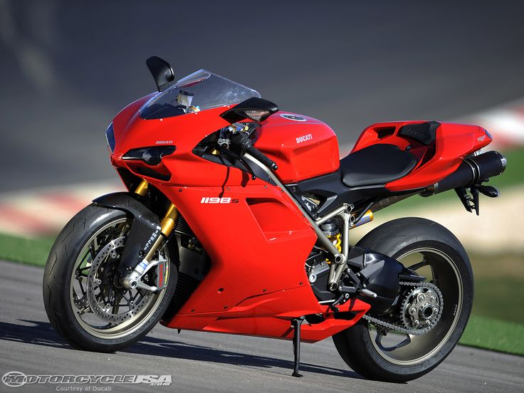 red Ducati flags whip in the wind along the front straight of the Autodromo Internacional Algarve circuit as a row of pristine 2009 Ducati 1198S superbikes ...