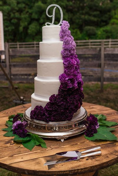 Purple + glam wedding cake idea - five-tier, fondant- frosted wedding cake with purple flowers and glitter cake topper {Jamie Ivins Photography}