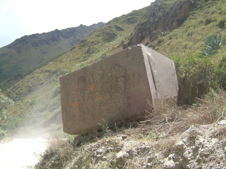 One of several massive blocks of rhyolite that were apparently left abandoned in the Sacred Valley between the quarry and the Temple of the Sun, at Ollantaytambo. Abandoned. or flung down? Ancient legends speak of the destruction of the ancient civilisation by a great flood called the Uñu Pachakuti, which swept down the altiplano from the north, obliterating everything in its path.