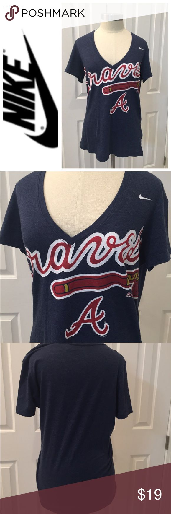 Nike Atlanta Braves Short Sleeve V Neck Shirt XL A must have for any Atlanta Braves fan. Navy blue Nike women's  v neck shirt sleeve shirt. Preowned, no rips or stains. Check out my closet to save on bundles, reasonable offers accepted. Nike Tops Tees - Short Sleeve