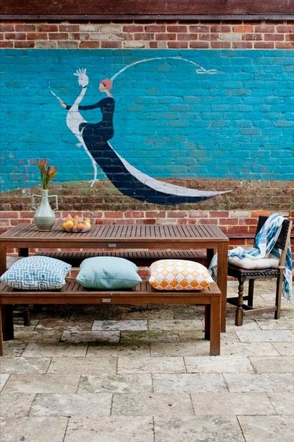 Wall murals are a fun feature to liven up a courtyard and provide an interesting backdrop to an otherwise boring old wall. Eclectic Patio by Etica Studio