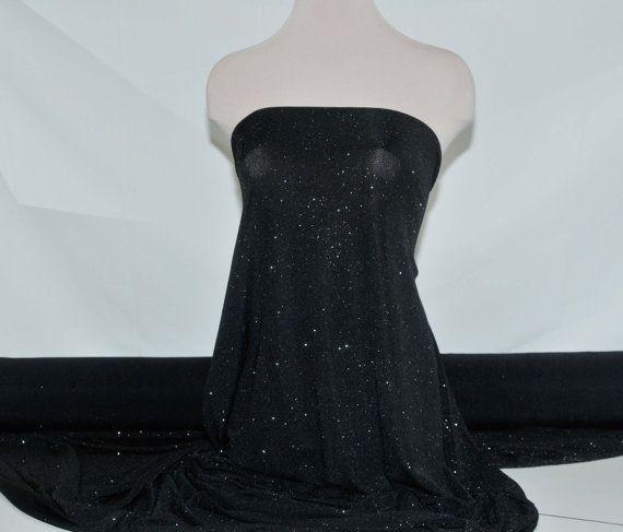 Slinky spandex glittered Black 4 ways stretch fabric .formal
