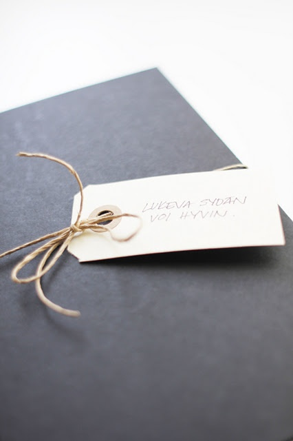 black wrap and shipping tag.