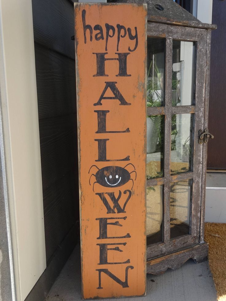 Happy Halloween sign. 6x26 vertical Halloween sign/ Halloween decor/ front porch Halloween sign/ Halloween home decor by MyThoughtsExactly6 on Etsy https://www.etsy.com/listing/526097540/happy-halloween-sign-6x26-vertical