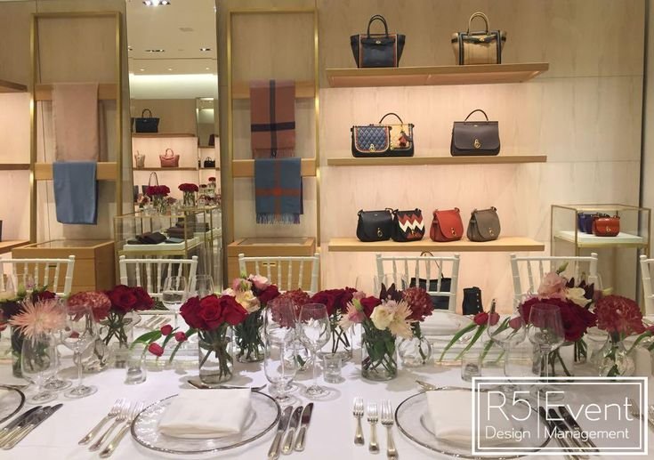 Private event for Mulberry Toronto. Deep crimson flowers with monochromatic red- By R5 Event Design