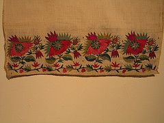 Tsevres from Thrace - stylized poppies with winding border.  Silk, gold and silver thread on cotton - Asia Minor stitch. The Greek Institute