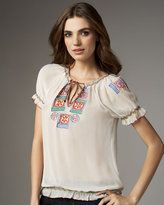 Reminds me of the traditional Romanian blouse with all the embroidery - I own one!