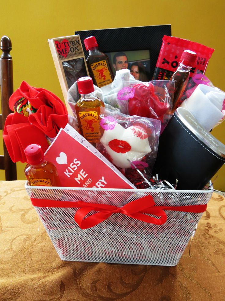 Man-Bouquet! Made this for my boyfriend and he loved it! Picture frame, alcohol shooters, a flask, boxers, t-shirt, and chocolate!