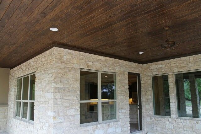 Texas Hill country house - Austin white limestone covered porch with tongue and groove pine ceiling.