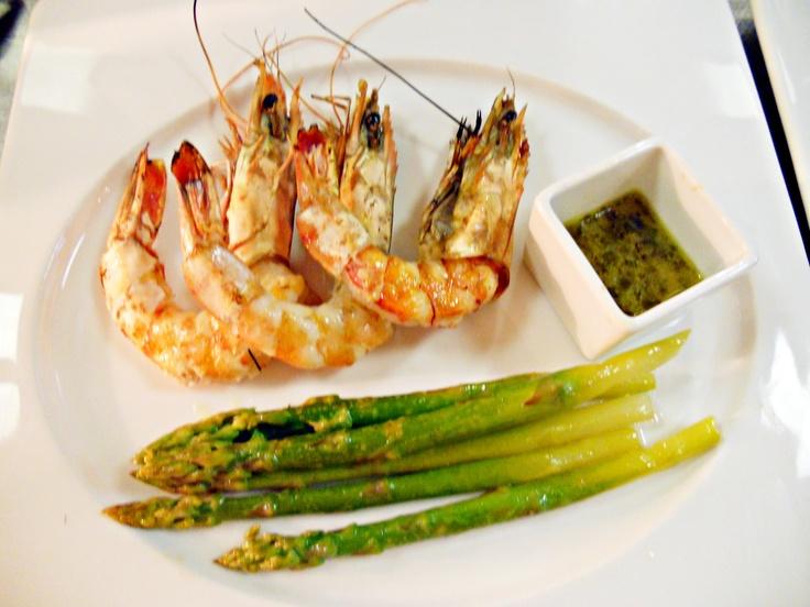 Succulent grilled tiger prawns served with lemon reduction