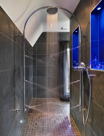 The Spacious Walk In Shower Area Features An Ultra Modern Arc With A Large  Overhead Shower Rose For An Invigorating Rinse.