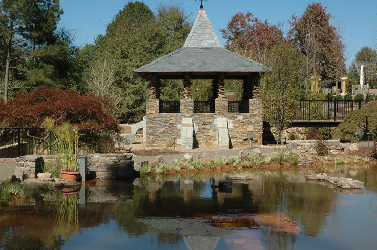 The Moon Keep next to Sunken Pond in Lost Hollow at Daniel Stowe Botanical Garden.