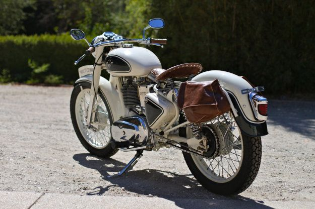 This beautiful cream-and-green Enfield 350 is a timeless classic—and we mean that literally. The number plate suggests 1955, but the VIN says 1973.