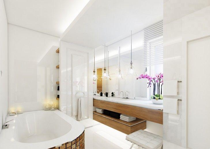 Wystrój wnętrza łazienki w apartamencie w Warszawie. W pomieszczeniu dominują naturalne biele i ciepłe odcienie drewna. Całość utrzymana w eleganckim świeżym stylu.