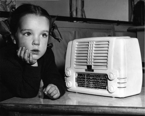 Ariane Dawson of Sydney, a young listener to Kindergarten of the Air, one of the ABC's first radio programmes for children.1943