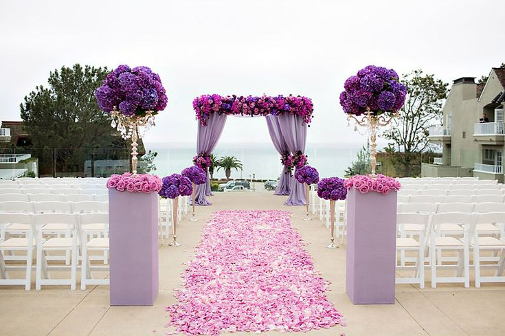Radiant Orchid Wedding Details: pink and purple floral ceremony decor | Photo: The Youngrens