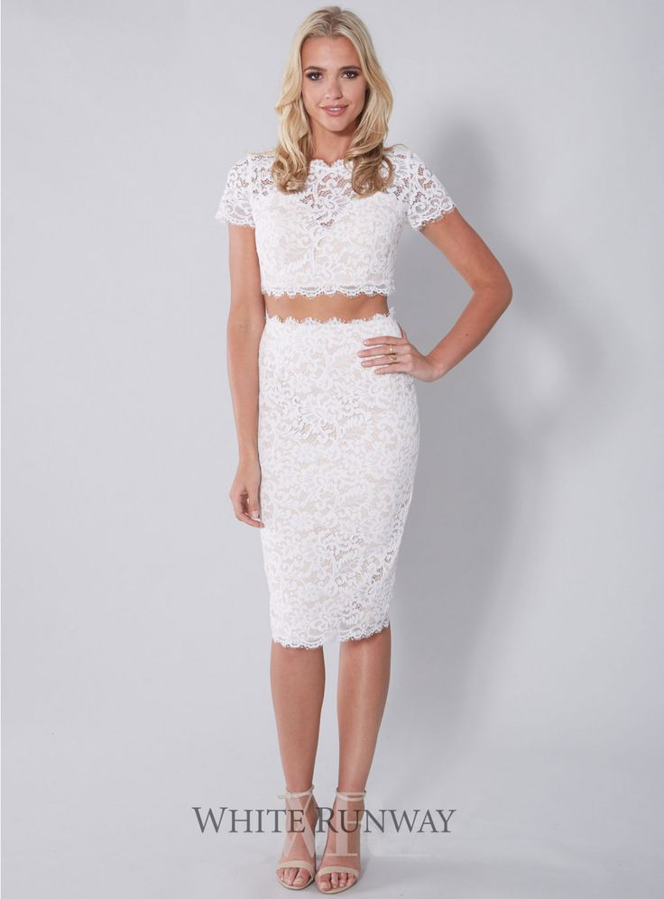 Antoinette Set. A stylish crop set designed by Leah Da Gloria for White Runway. A lace cap sleeved top with button enclosures on the back with matching lace midi skirt.