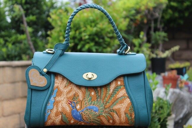 Beautiful Handbag with Hand drawn batik and premium cow leather and suede inside. Super cute!