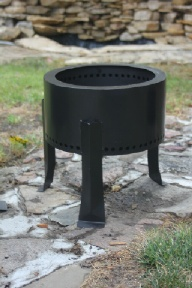 This is a Pellet Fire Pit.  They burn more cleanly and hotter than wood fires by using wood pellets.  Pellets are cheaper than wood too, about 5 bucks for 40lbs bag, and you don't have to worry about the rules some places have about bringing wood in.  This one is a medium size and it's $125Check it out on PelletFirePit.com.