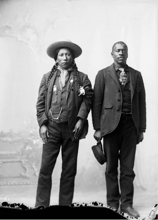 A Native American Ute man, identified as Dick Charlie and an African American man, John Taylor - 1880/1910