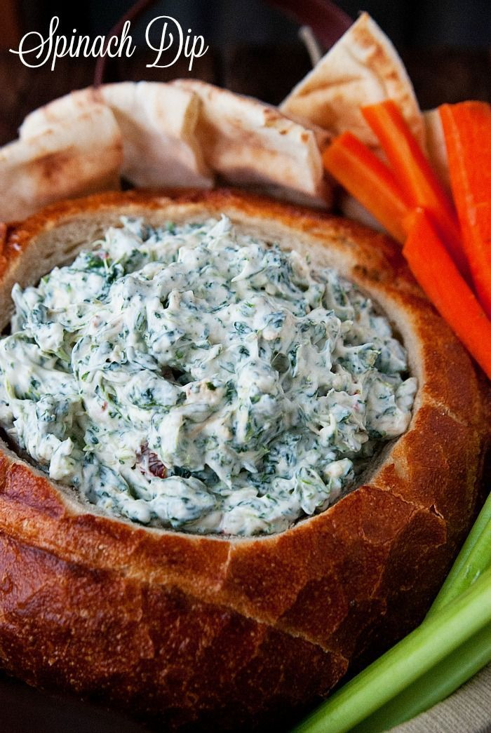 Spinach dip is always a big hit at gatherings. It's perfect for picnics and football parties. Serve it in a bread bowl or on it's own. It's delicious any way you eat it.  via @Just 2 Sisters