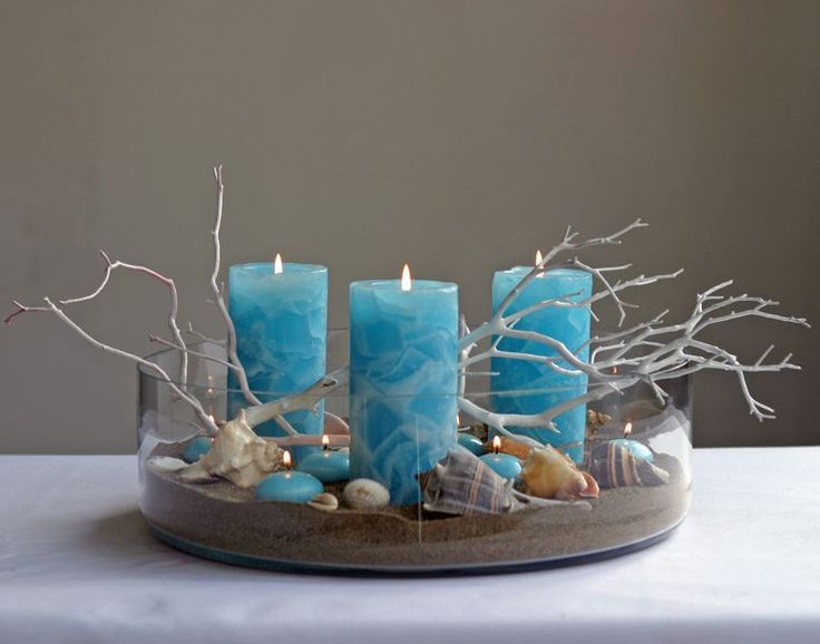 Beach centerpiece using blue pillar candles. Great Affordable Idea if you Stock up on the Candles!