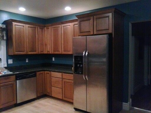 My kitchen remodel dark granite cherry cabinets teal for Teal kitchen cabinets