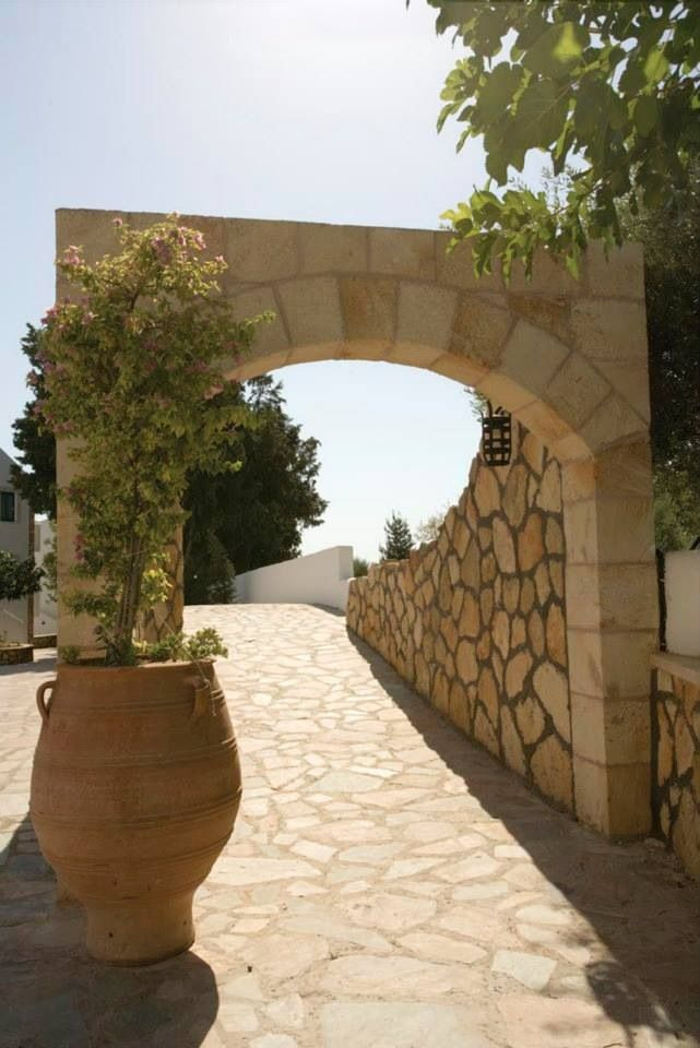 The archway is the start if the brides aisle to the Veranda for the wedding. www.weddingsinblue.gr