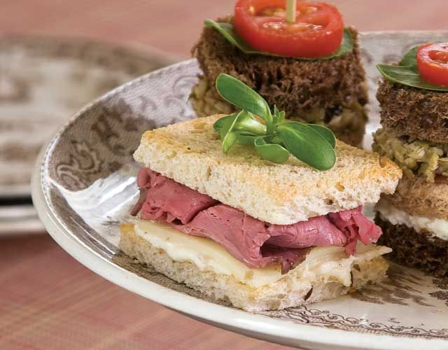 All the best flavors of a classic roast beef sandwich are presented here: rye bread, Swiss cheese, and Horseradish Cream.