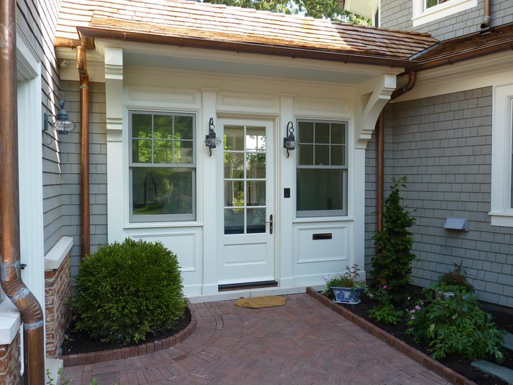 COOK ARCHITECTURAL Design Studio | This breezeway connects the 3-car garage to the house, while providing a place to store coats and shoes on the way in.