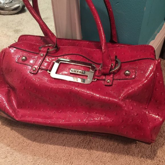 Older pink Guess bag Pink guess bag and has some wear on it but still good enough to love! Guess Bags