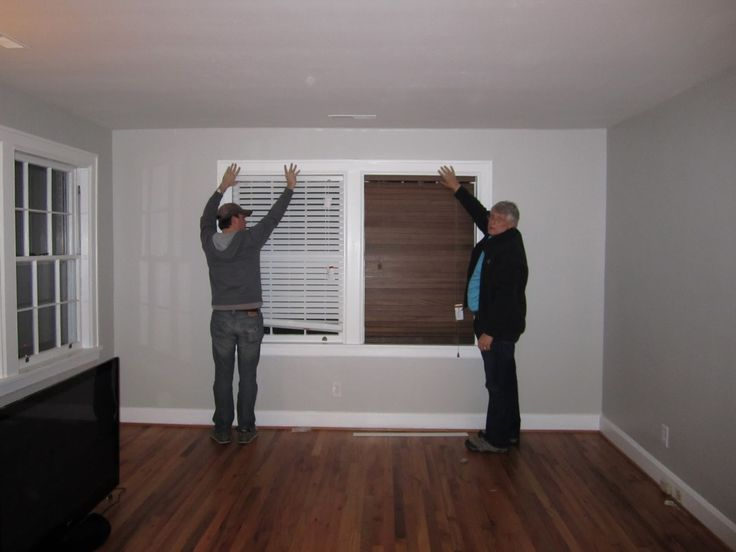 White or Brown wood blinds with grey walls white trim, hard wood floors