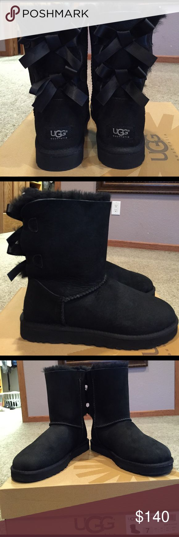 New UGG Bailey Bow Boots Have been sprayed with UGG sheepskin protector. Worn for about an hr only. UGG Shoes Winter & Rain Boots