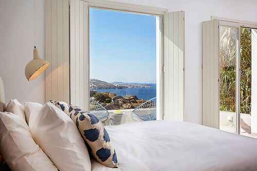 A view of the Aegean Sea surrounding Mykonos island can be seen from the Classic Sea View Suite. You can see more information at http://www.bohememykonos.com/sea-view-suite-mykonos-town