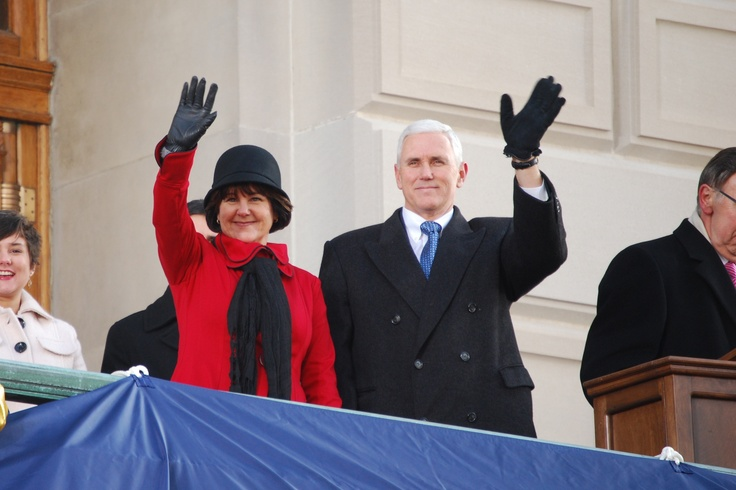 Gov. Mike Pence and first lady Karen Pence waving to the inauguration crowd.